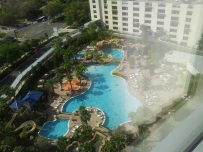 The view from our room, sixteen floors up, down to the gigantic pool.